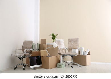 Moving boxes and furniture in new office. Space for text