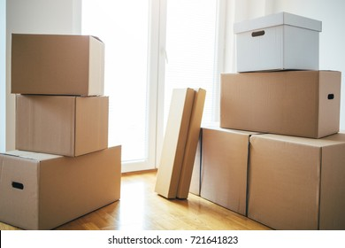 Moving boxes in new apartment. Moving into a new apartment