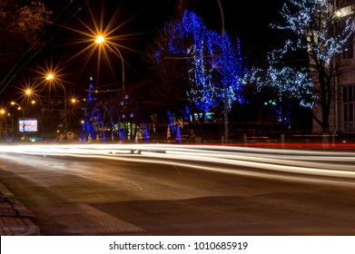 Moving car with blur light through city at night.