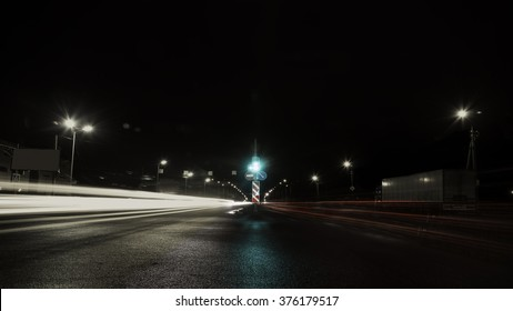 moving car with light through city at night