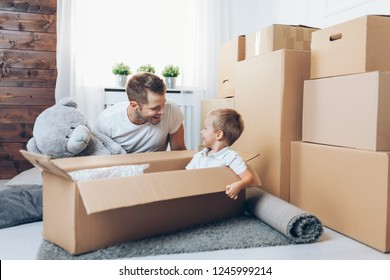 Moving concept, Father and his son moving into their new home