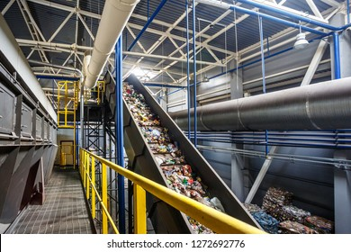 moving conveyor transporter on Modern waste recycling processing plant. Separate and sorting garbage collection. Recycling and storage of waste for further disposal.