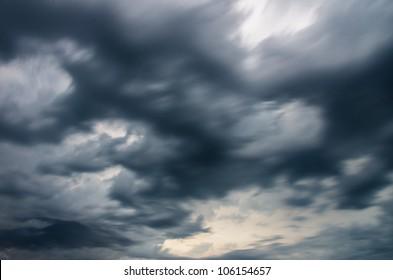 moving dark storm clouds before rain