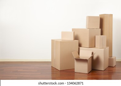 Moving day, cardboard boxes in apartment