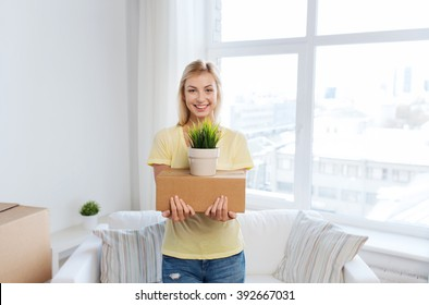 moving, delivery, accommodation and people concept - smiling young woman with cardboard box at home