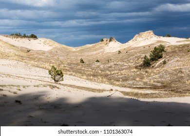 Moving dunes with dramatic sky near Leba, Poland. The dunes are the largest dunes in Europe.