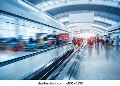 moving escalator in airport terminal with motion blur