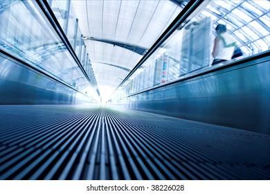 Moving escalator inside modern hall