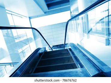 Moving escalator in morden building.