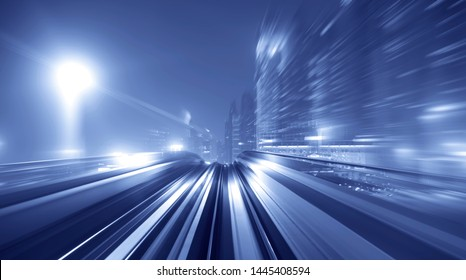 Moving Fast on Railroad Track with High Speed Train Railway Rushing Through the City Streets
