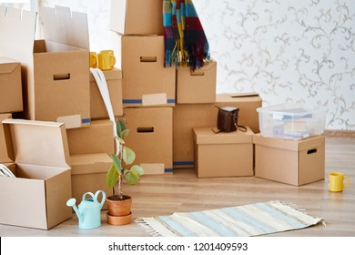 Moving in. Stack of cardboard boxes in room of new home