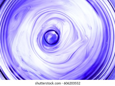 moving ink in water spiral abstract, purple and white
