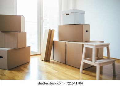 Moving into a new house. Moving boxes in new apartment