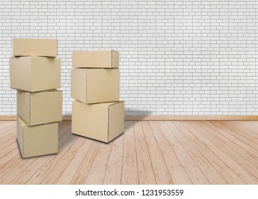 Moving in new home or apartment, office . Empty room with Brown Carton boxes