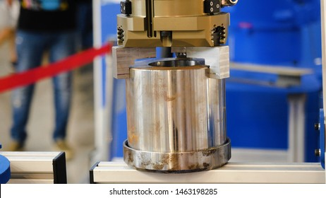 Moving part of robotic arm machine tool. Media. Robotic arm uses a billet item for work