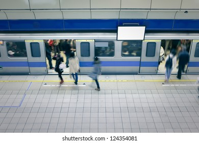 moving people enter carriage at a metro railway station with blank tv billboard, shot in Taipei, Taiwan, asia