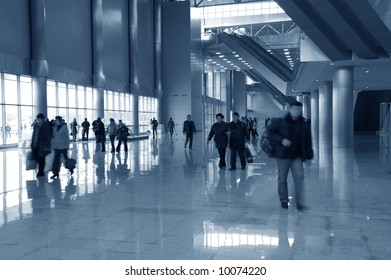 moving  people in hall of modern building