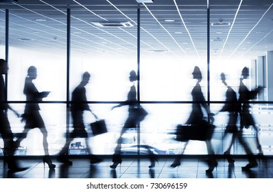 moving silhouettes of businesspeople interacting office background