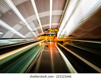 Moving stairs in an airport with different colors