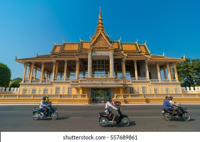 The moving traffic of the Cambodian capital in front of the Royal Palace in Phnom Penh, Cambodia.