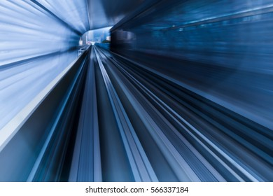 Moving train out of tunnel, blurred motion background