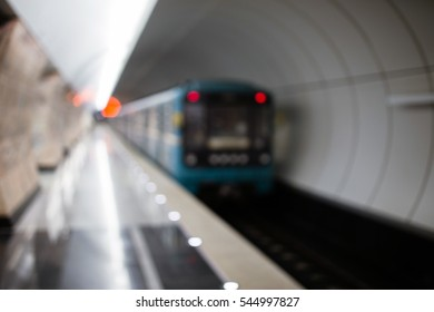 Moving train in subway tunnel, blurred.a