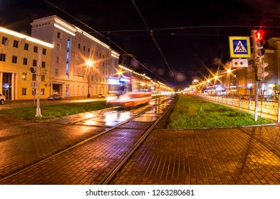 Moving tram on the track at night near the Moskovskiye Vorota (Moscow Triumphal Gate, St Petersburg), Russia