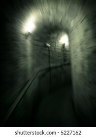 Moving trough long dark  corridor . Zoom motion effect photo.