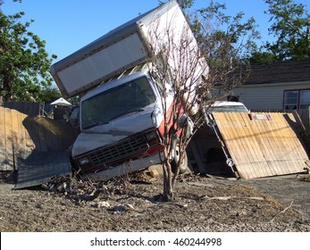 Moving truck on residential fence - Hurricane Katrina