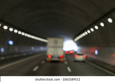 Moving vehicles in a long tunnel to its end in a distance perspectively .Picture blurred intentionally for a special aspect.