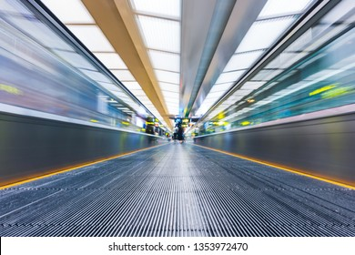 Moving walkway or travelator with motion blur at international airport