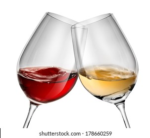 Moving wine in two wineglasses isolated on white