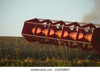 Mower from a combine harvester in action on a field