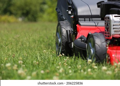 Mower  Lawn mower on the grass during the summer day