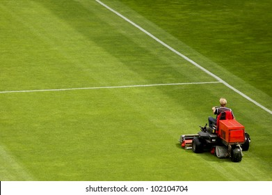 Mowing grass in a football stadium