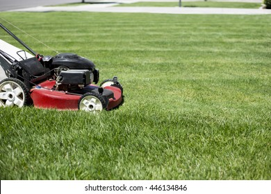 Mowing the lawn in the front yard beautiful green grass