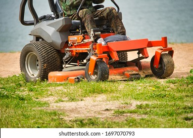 mowing lawns on a mechanized device