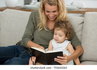 moyher reading story to little girl