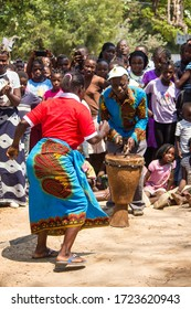 Mozambique - February 03 2020: Women dancing and singing dressed in colorful traditional African fabrics known as capulana in Mozambique