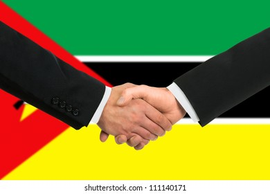 The Mozambique flag and business handshake