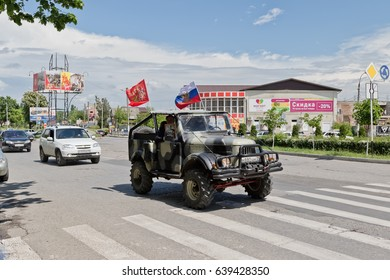 MOZDOK, RUSSIA - MAY 9: Cars decorated with flags driving around city streets in celebration of the victory day. May 9, 2017  in  North Ossetia-Alania, Mozdok, Russia