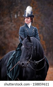"""MOZHAISK, MOSCOW- OCTOBER 5,  2013: Historical reconstruction of famous russian hounds hunting by horse club """"Avanpost"""". Elena Potapova and horse Baksan"""