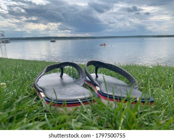 Mozhaysk, Moscow region, Russia - 17 August 2020: Pepe jeans flip flops with beautiful landscape.