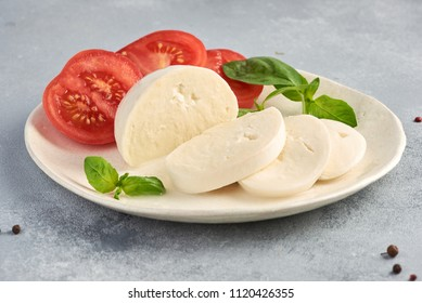 Mozzarella Buffalo with basil leaves and tomatoes.