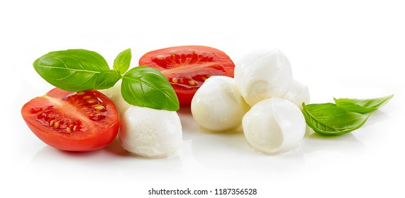 Mozzarella cheese balls with basil and tomatoes isolated on white background