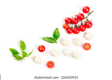 Mozzarella cheese balls with fresh basil leaves and cherry tomatoes, the ingredients of the Italian Caprese salad, shot from the top on a white background with copy space