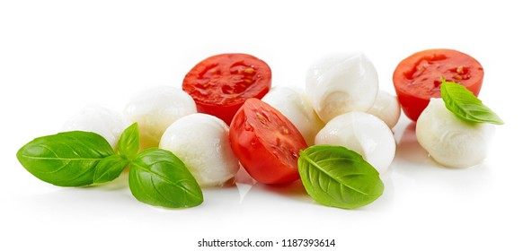 Mozzarella cheese balls with tomato and basil isolated on white background