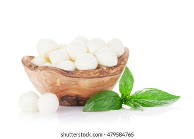 Mozzarella cheese and basil herb leaves. Isolated on white background
