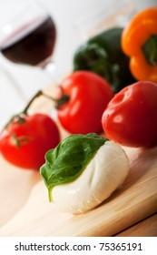 mozzarella cheese and a basil leaf