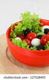 Mozzarella, cherry tomatoes and olives salad